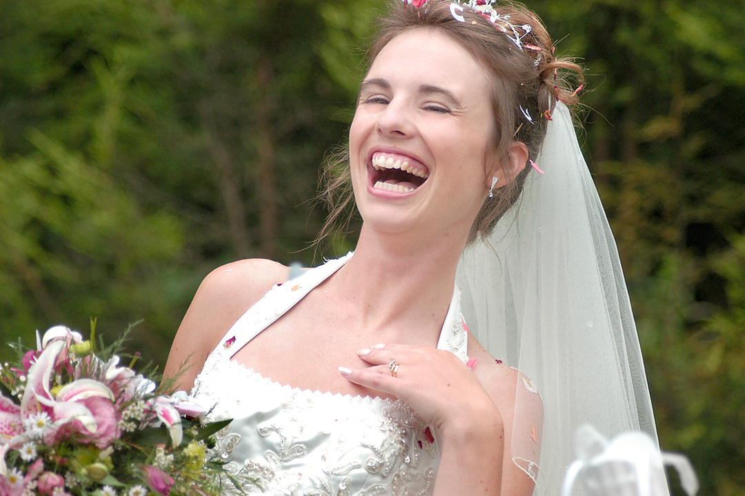 bride enjoying being photographed at her wedding