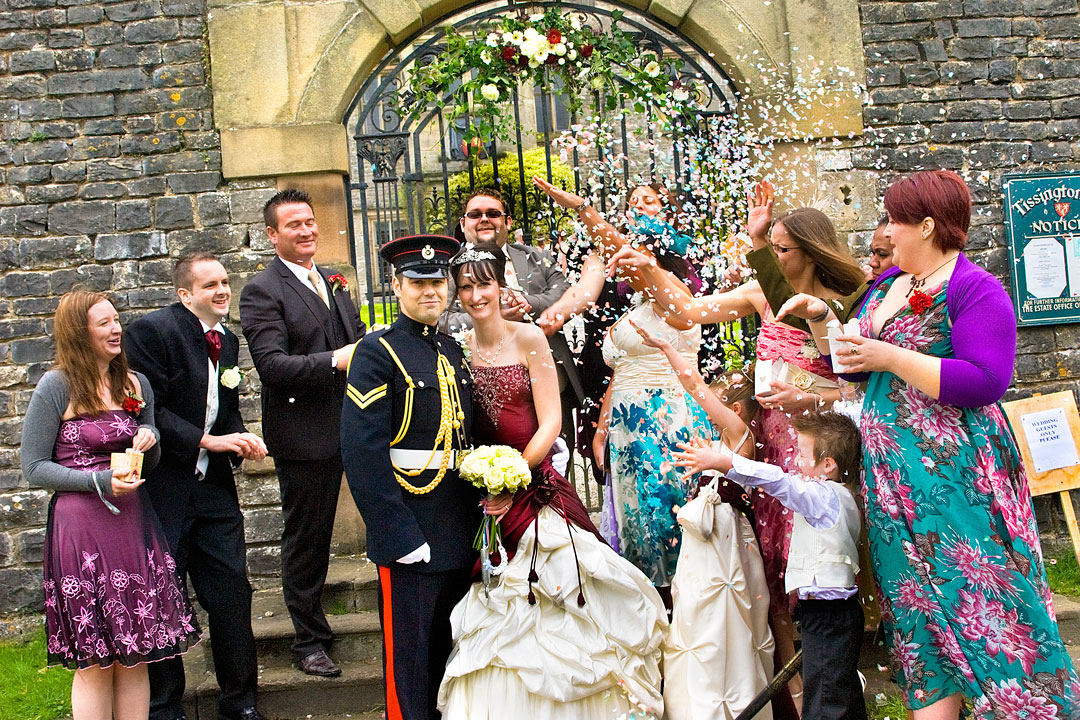 confettin being thrown at wedding in Tissington, Derbyshire