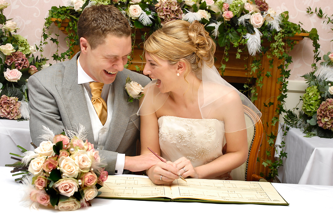 Signing the register at Izaac Walton Hotel, in Dovedale, Derbyshire