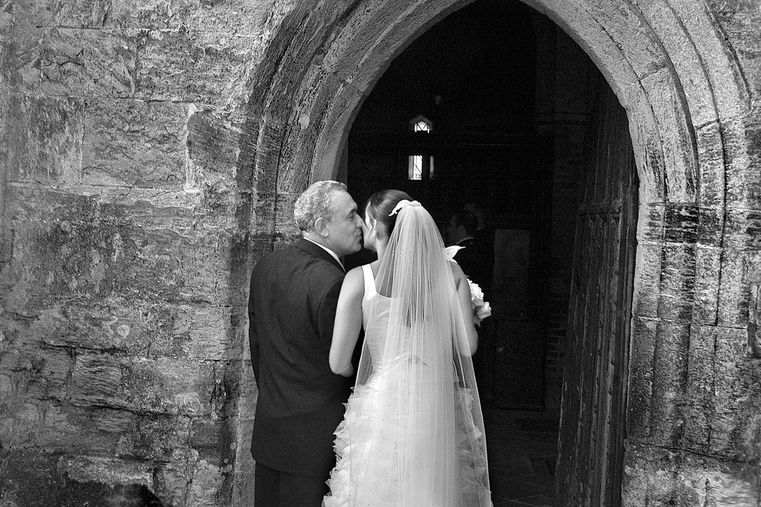 Photography of father giving bride away in church in East Midlands