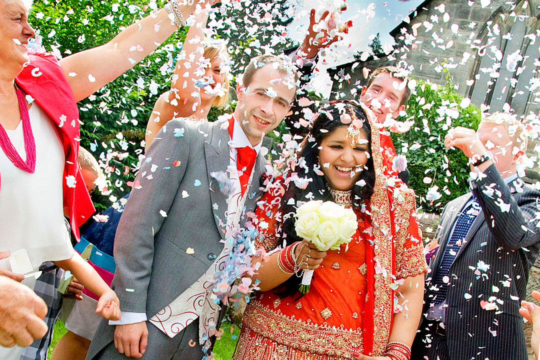 confetti being thrown at Derbyshire church wedding