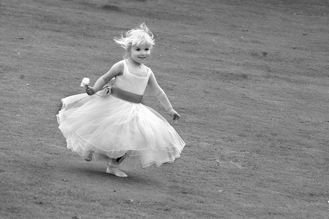 bridesmaid running down hill in Derbyphotograph