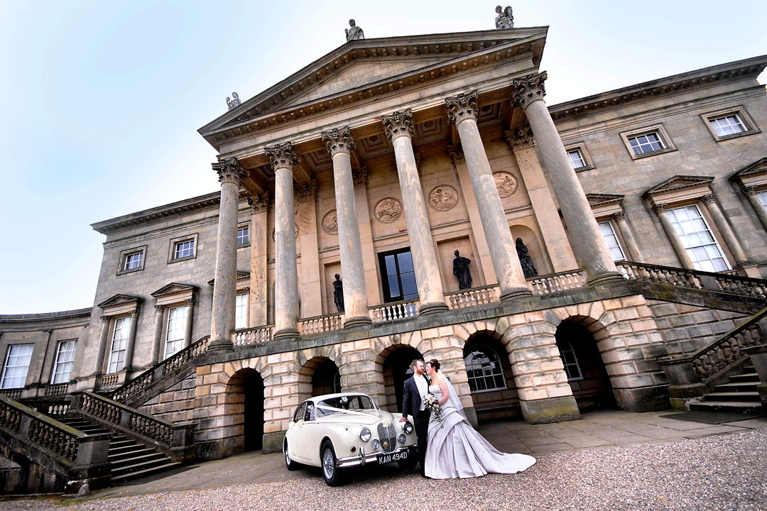 bride and groom in front of Kedleston Hall, Derbyshire